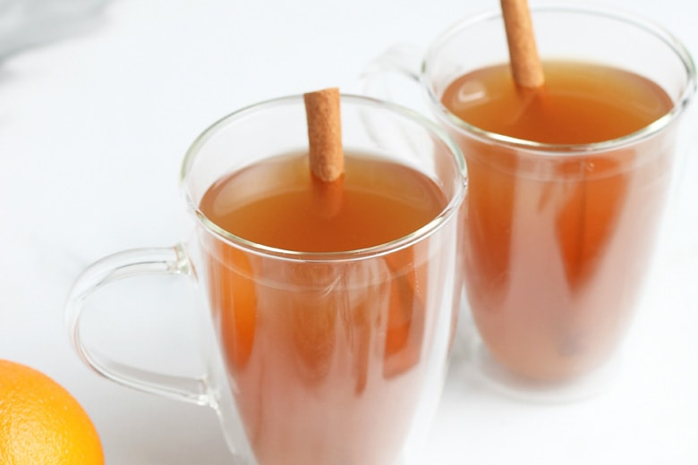 side view of mulled cider in glass mugs