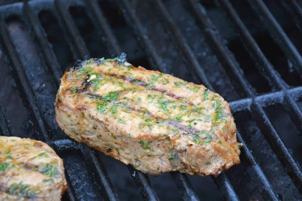 thick pork chop on a grill