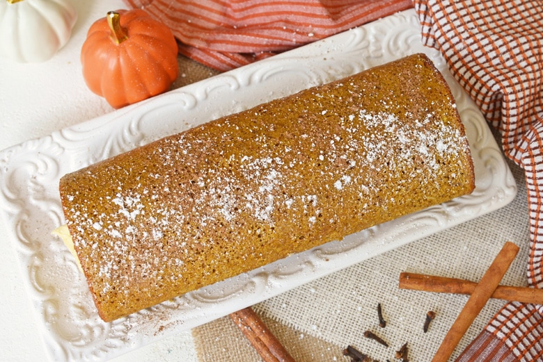 overhead of pumpkin cake roll dusted with powdered sugar