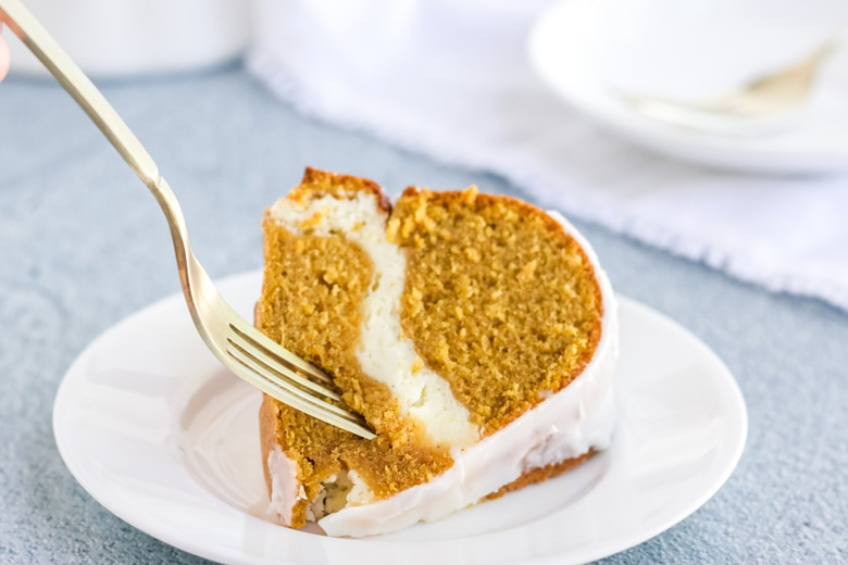 fork digging into a slice of pumpkin cream cheese pound cake