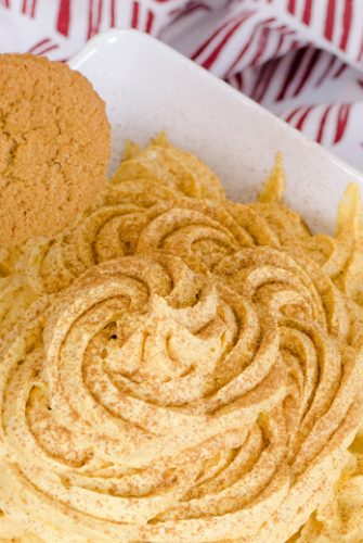 gingersnap dipping into pumpkin dip