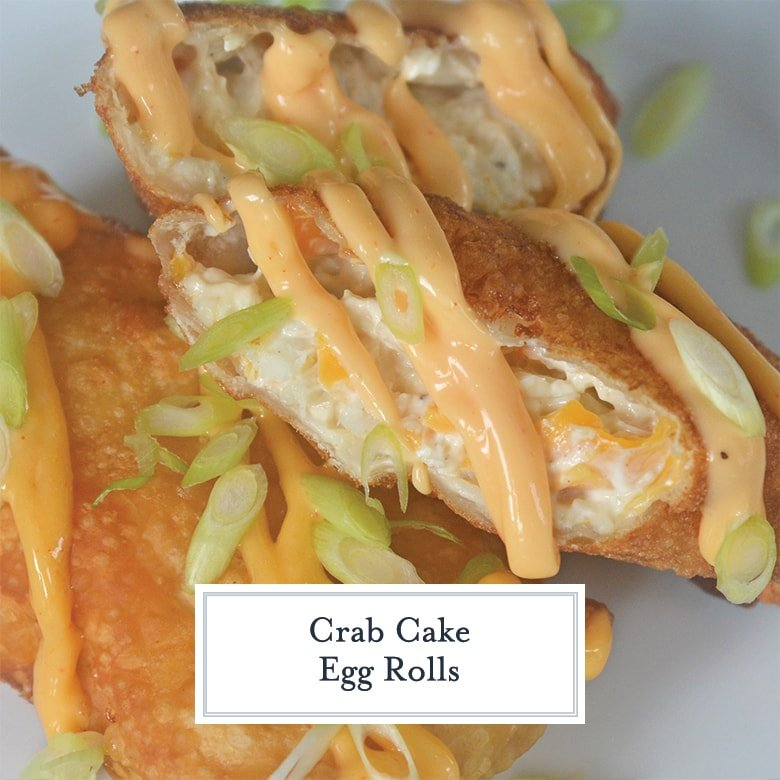 close up of crab cake egg roll with sauce