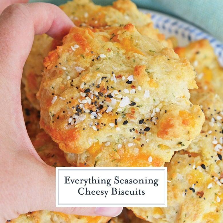 hand picking up everything bagel seasoning biscuit