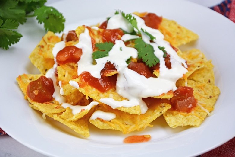 Mexican crema on top of nachos