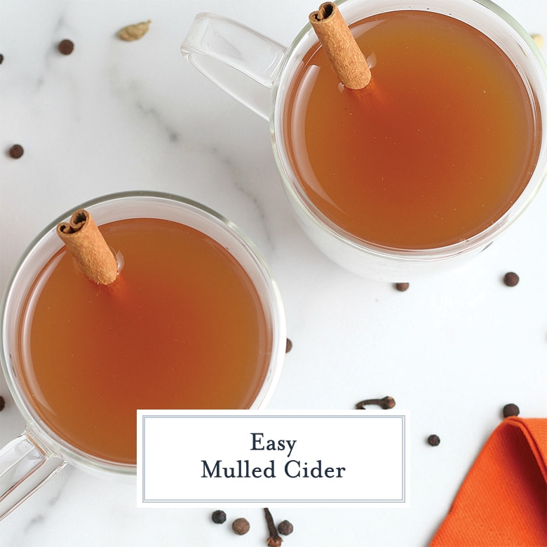 overhead of mulled cider with cinnamon sticks