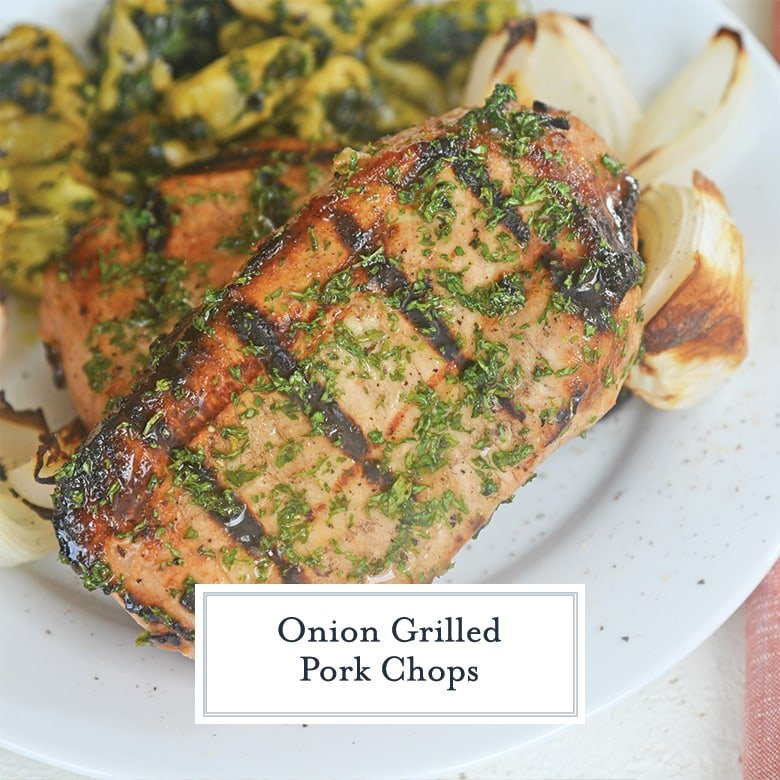 thick pork chop with grill marks and parsley
