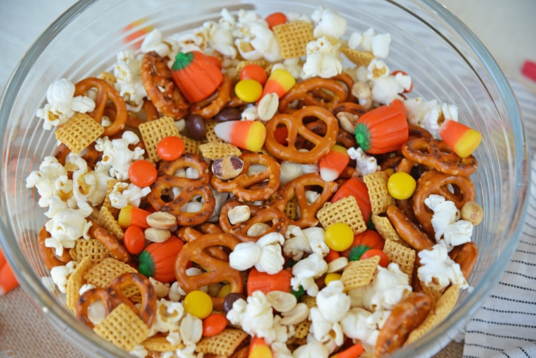 no bake sweet and salty snack mix in a glass mixing bowl