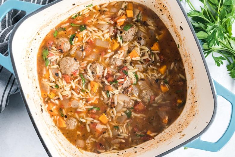 italian meatball soup in a cast iron pot