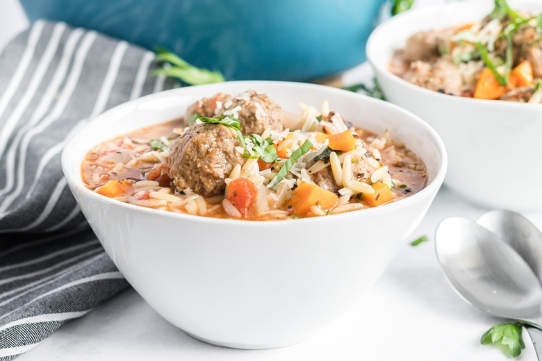 side view of meatballs in a soup bowl