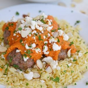 pile of lamb meatballs with romesco sauce