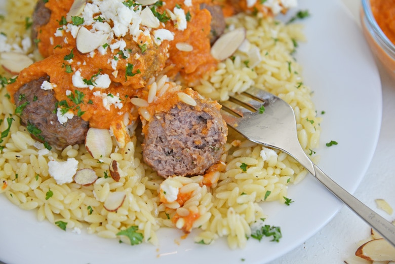 lamb meatball cut in half with a fork