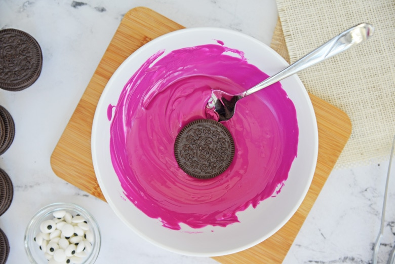 cookie dipping in purple chocolate