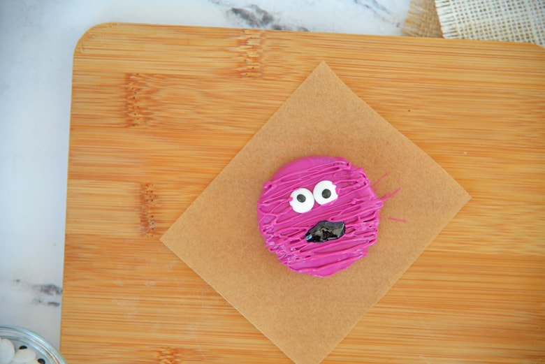 creating a glitter mouth on a chocolate covered oreo cookie