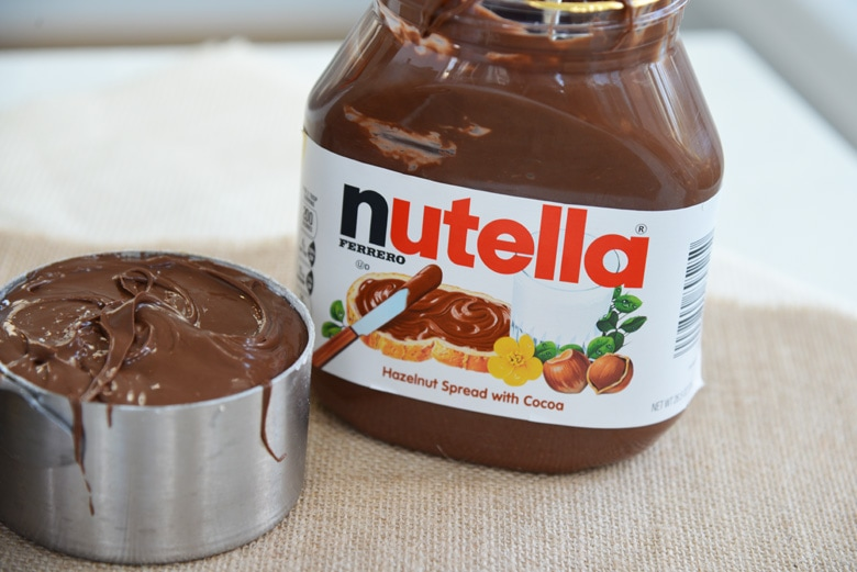 jar of nutella and a measuring cup