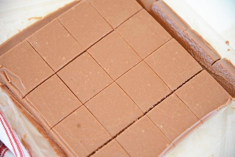 cut squares of fudge in a baking pan
