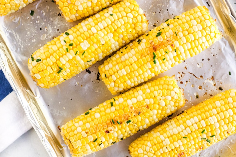 close up of staggered corn on a lined baking sheet