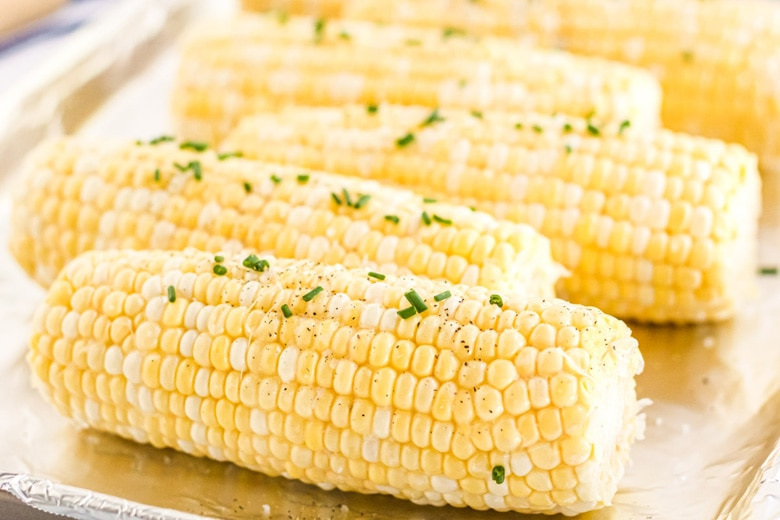 raw corn with salt, pepper and chives