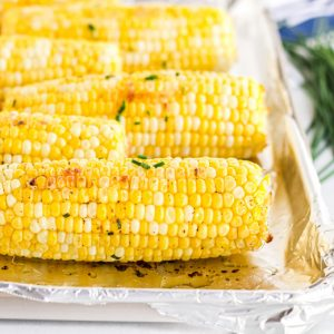 close up of oven roasted corn with chive butter