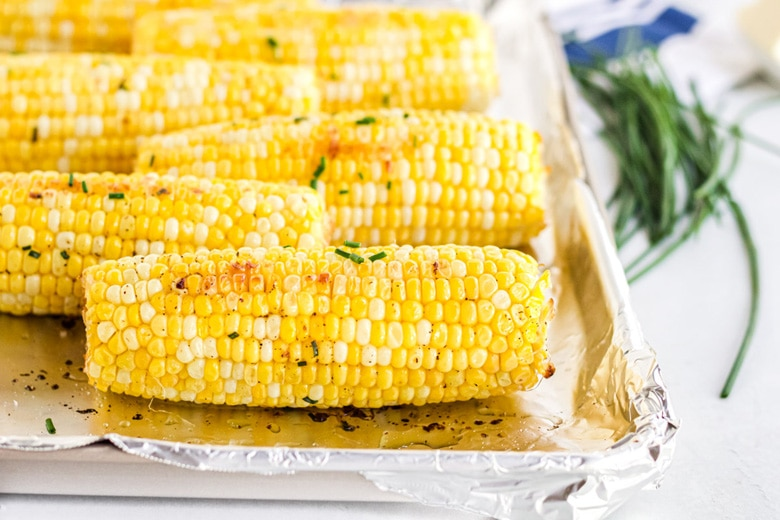 oven roasted corn on the cob with chives