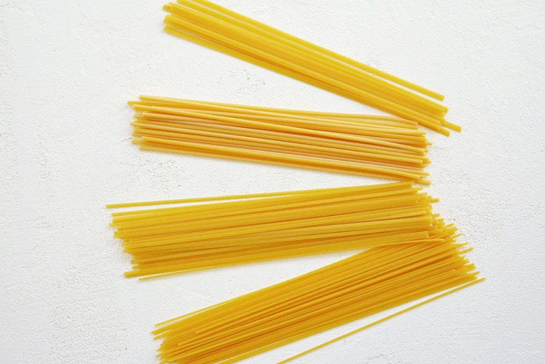 image of fettuccine, linguine, spaghetti and bucatini pastas to show size variations