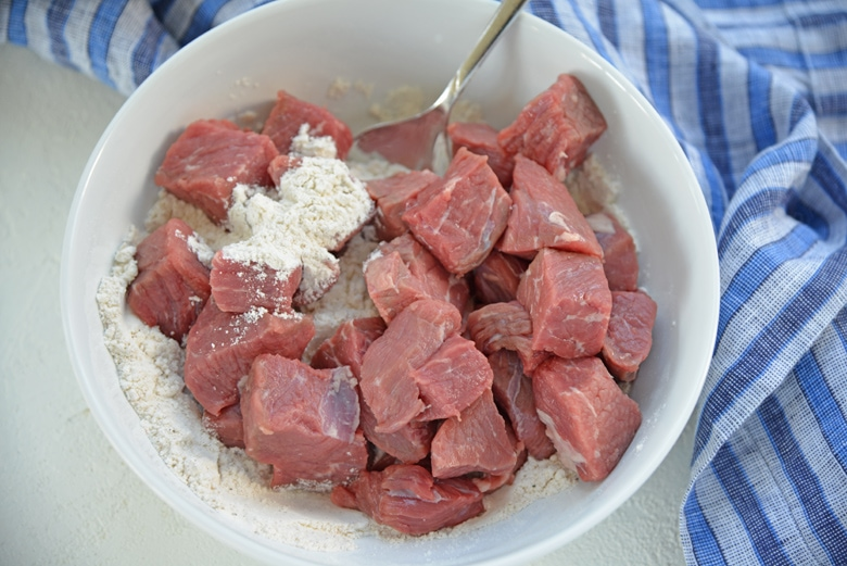 raw beef cubes tossed in seasoned flour