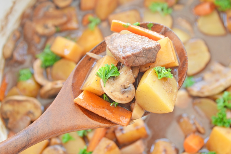 wooden spoon with beef, potatoes and parsnips
