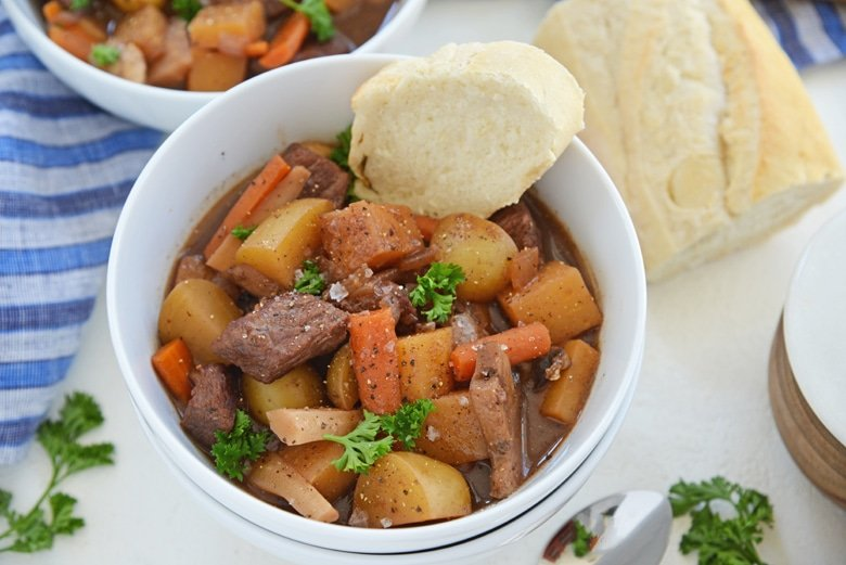 slice of bread in a bowl of beef stew
