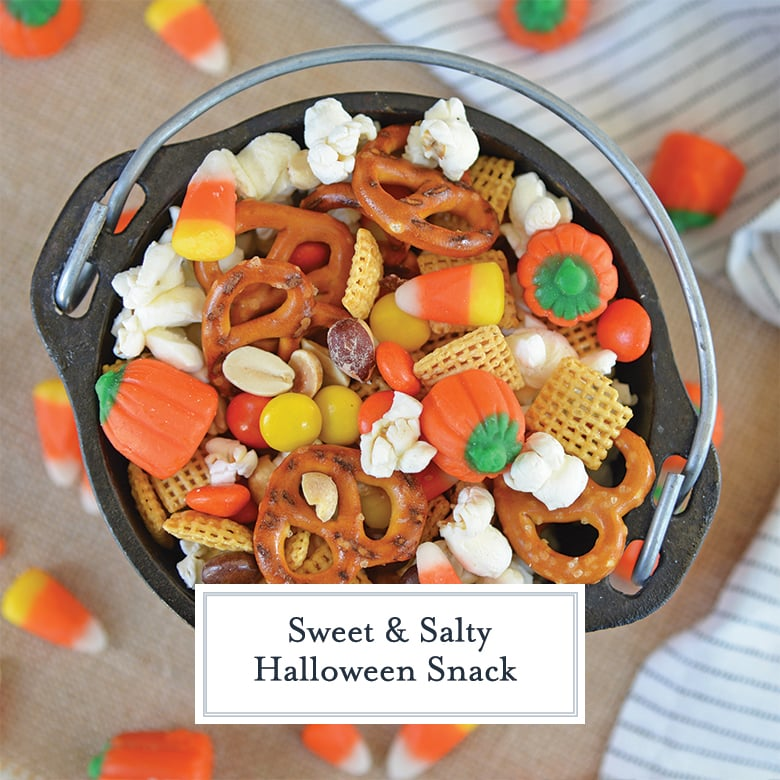 overhead of halloween snack mix in a small cast iron cauldron