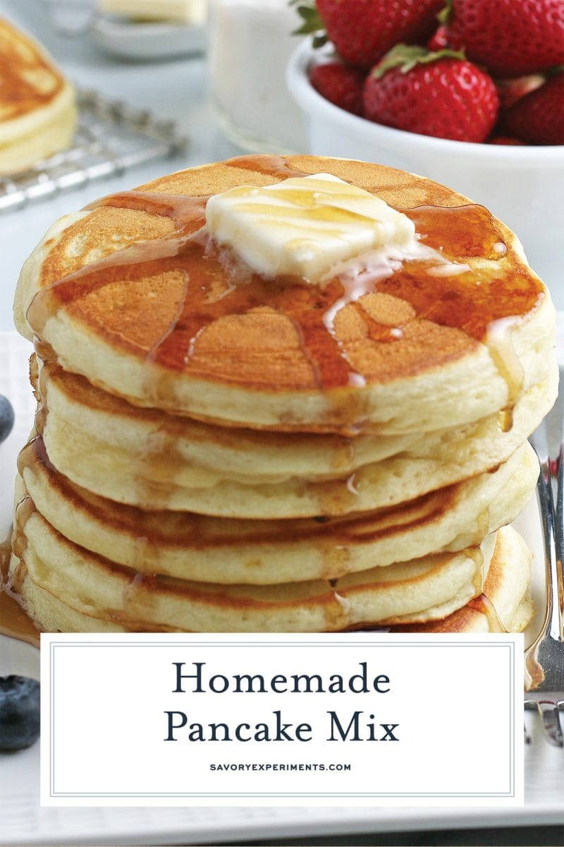close up of a stack of pancakes with syrup and butter