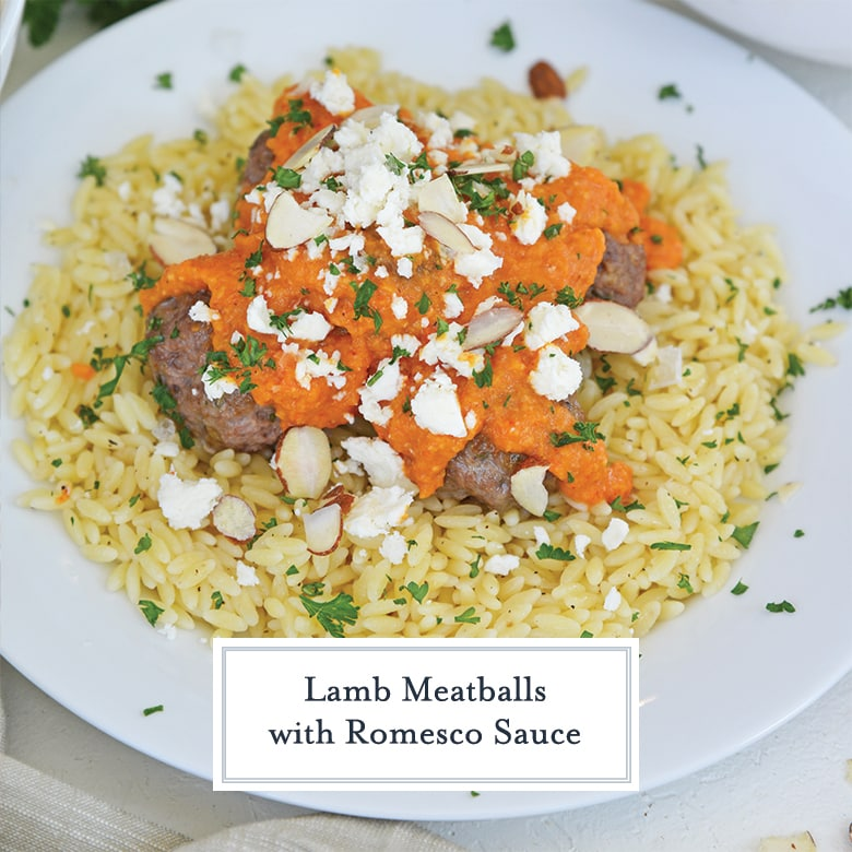 pile of lamb meatballs with tomato sauce, feta and almonds
