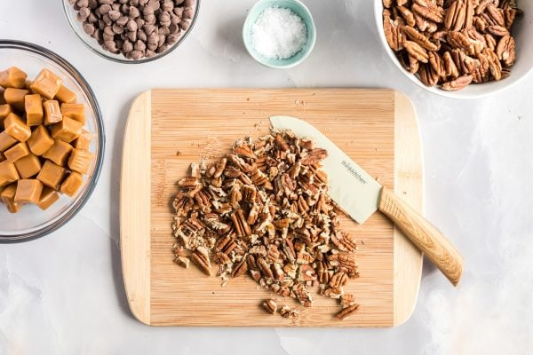 chopped pecans on a cutting board