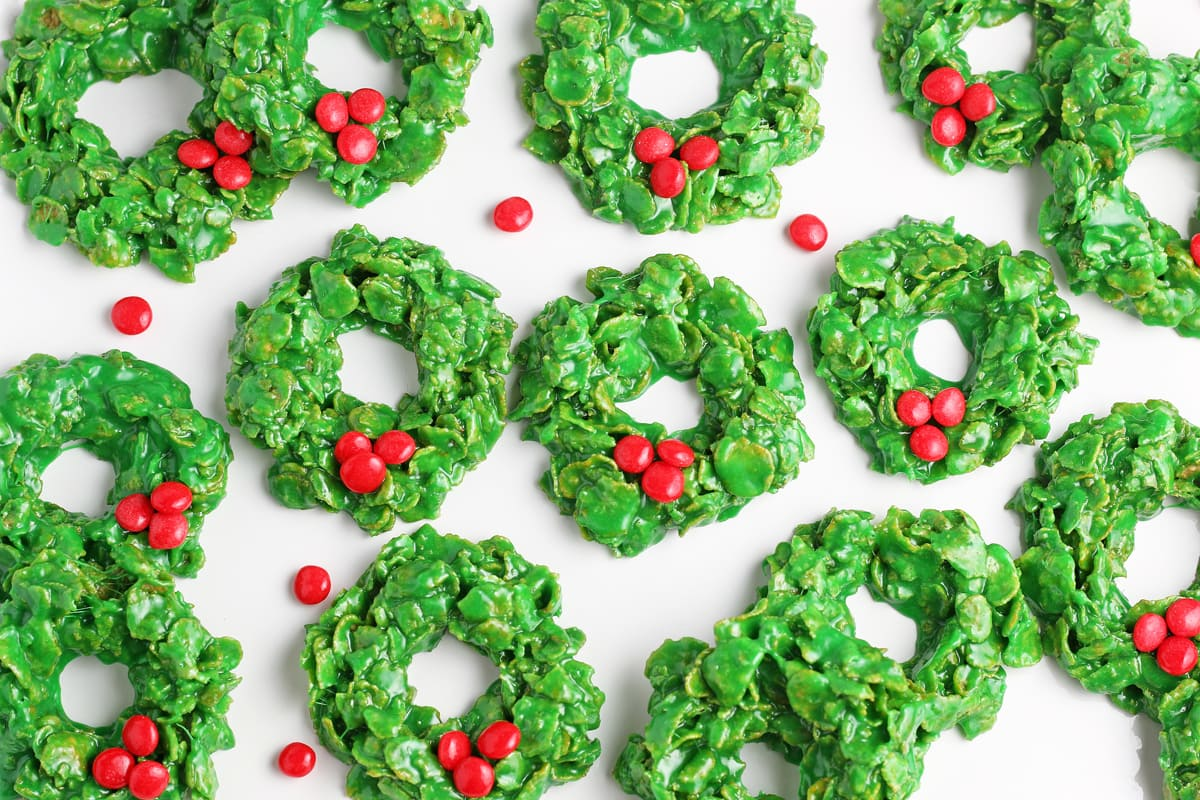 overhead of christmas wreath cookies on parchment