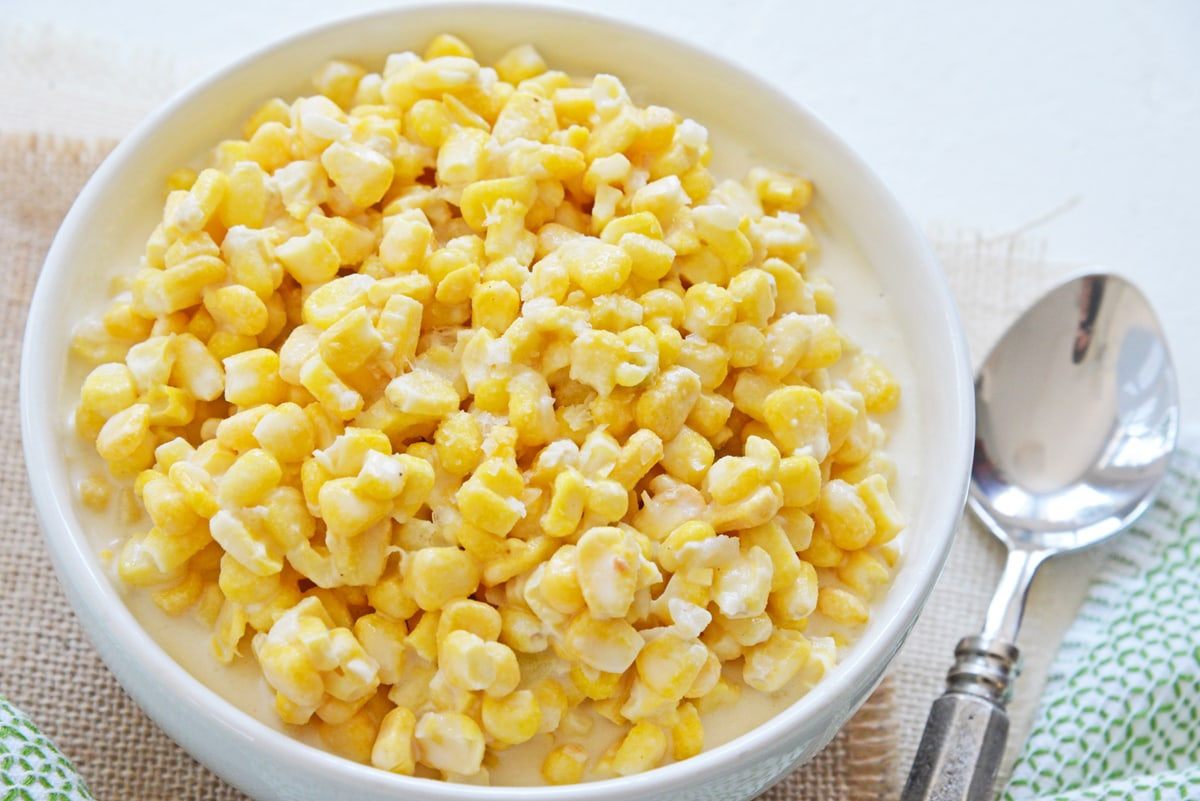 angle of homestyle creamed corn in a white serving bowl