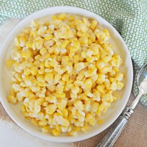 creamed corn in a white serving bowl