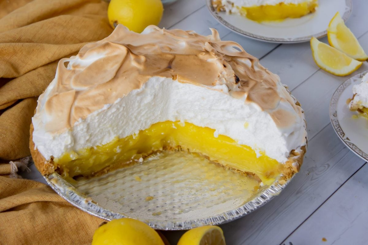 A classic Lemon Meringue Pie is something everyone needs in their recipe box! Check out all of my favorite tips & tricks for the best pie! #lemonmeringuepie #classiclemonmeringuepie www.savoryexperiments.com