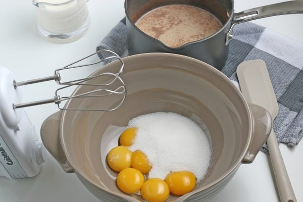 egg yolks with sugar in a bowl