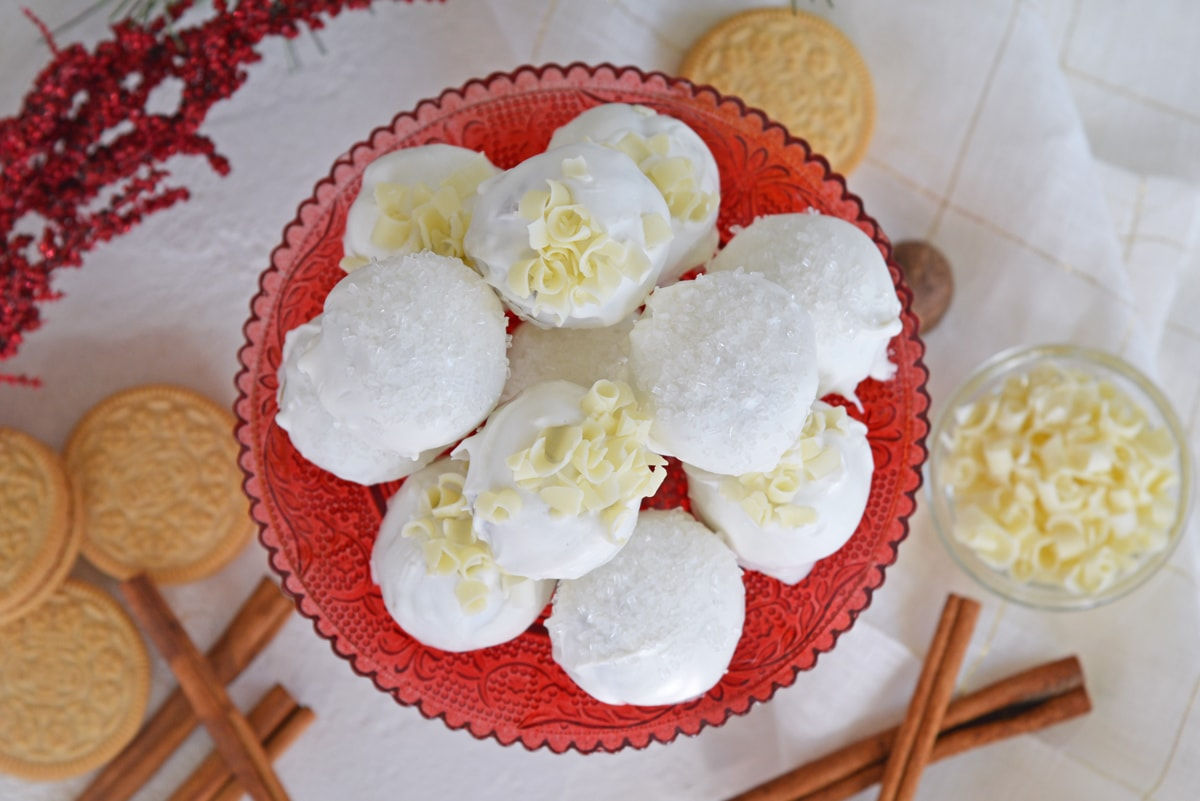 overhead of eggnog oreo cookie balls on a red platter