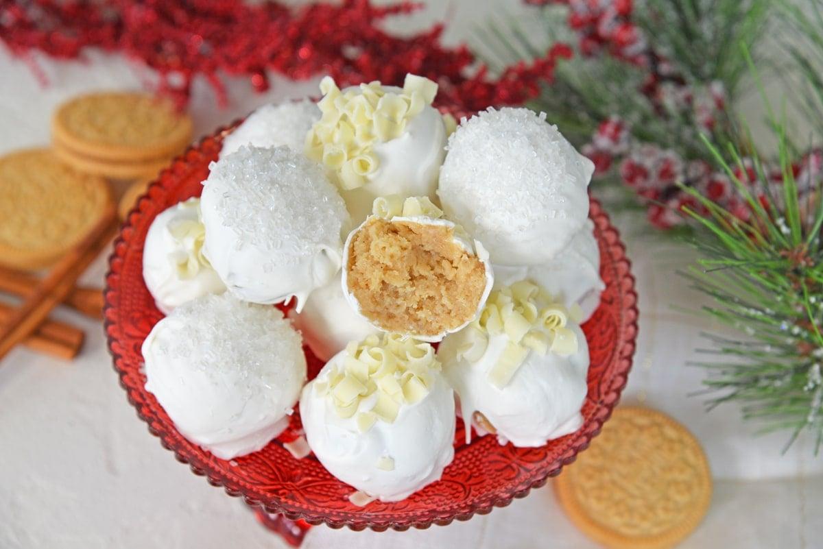 platter of eggnog oreo cookie balls with one half eaten