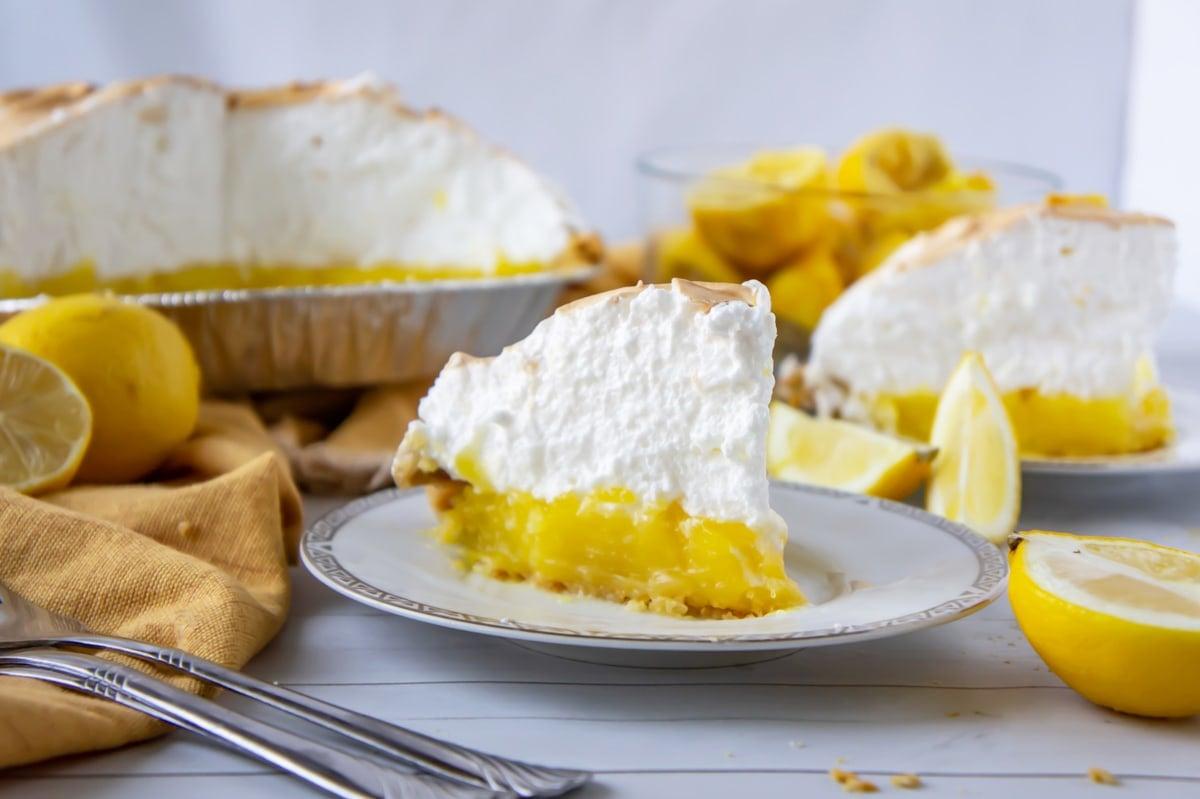 serving a slice of lemon meringue pie