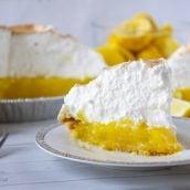 Slice of lemon meringue pie on a white plate