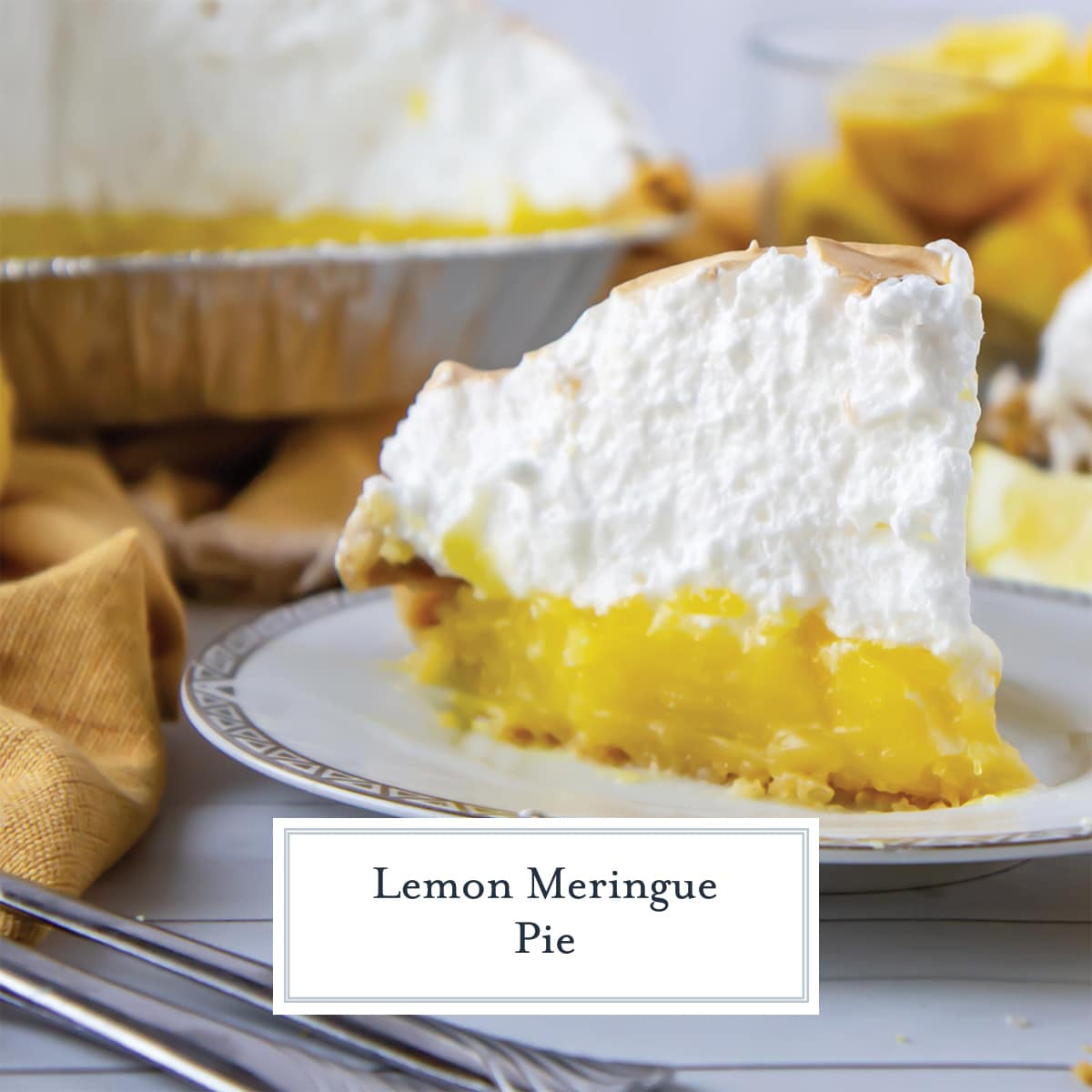tall slice of lemon meringue pie on a gold and white plate