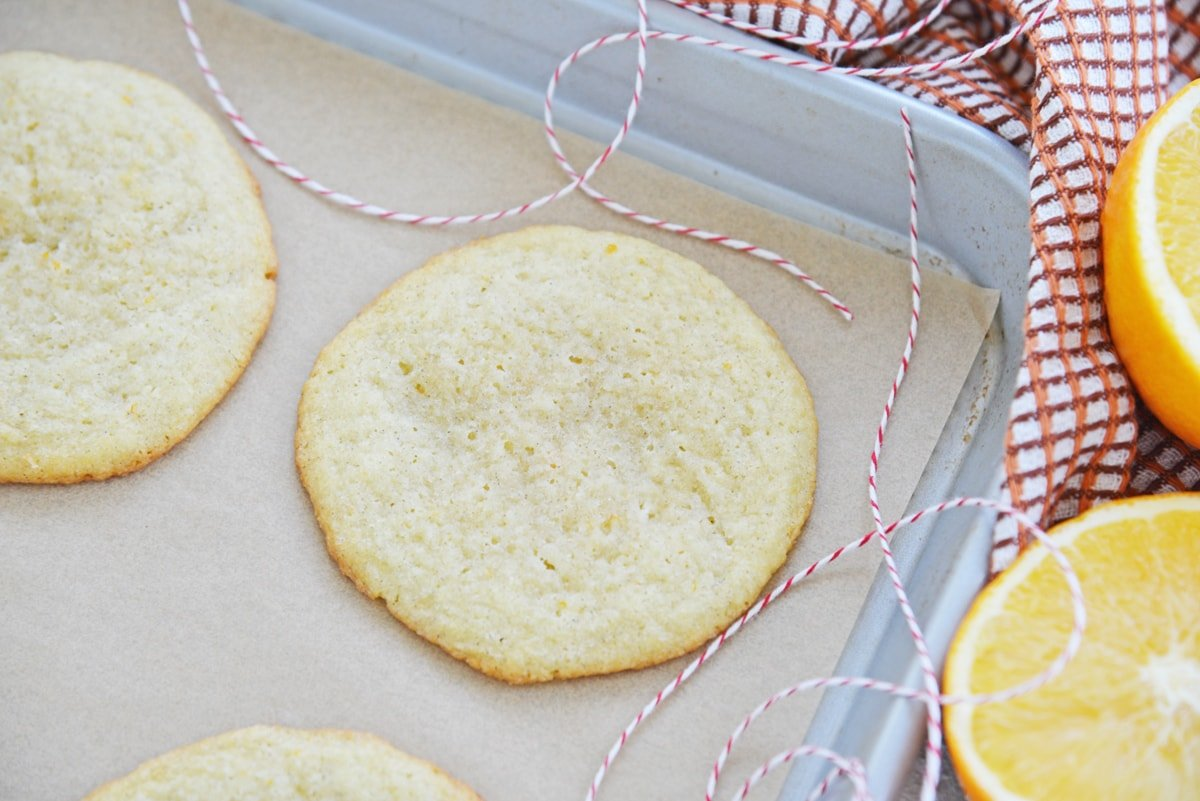 baked cookie on a cookie sheet with red twine
