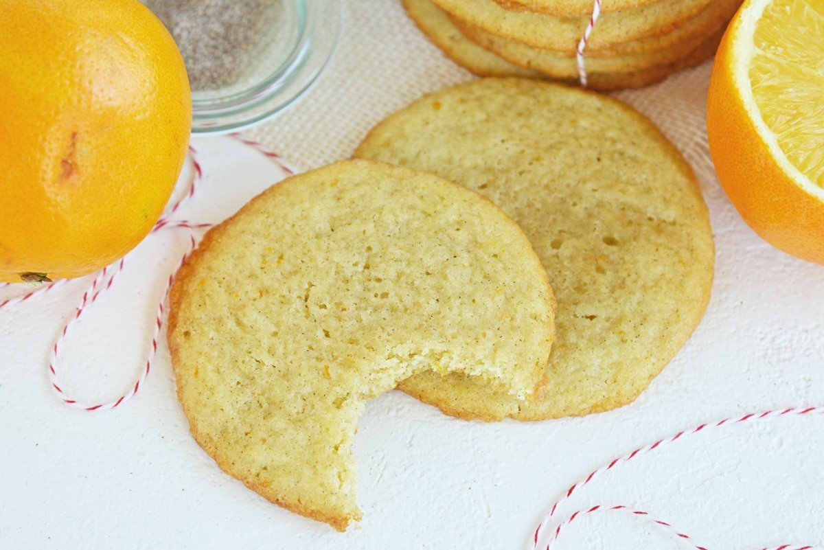 cookies with a bite taken out of it and fresh oranges