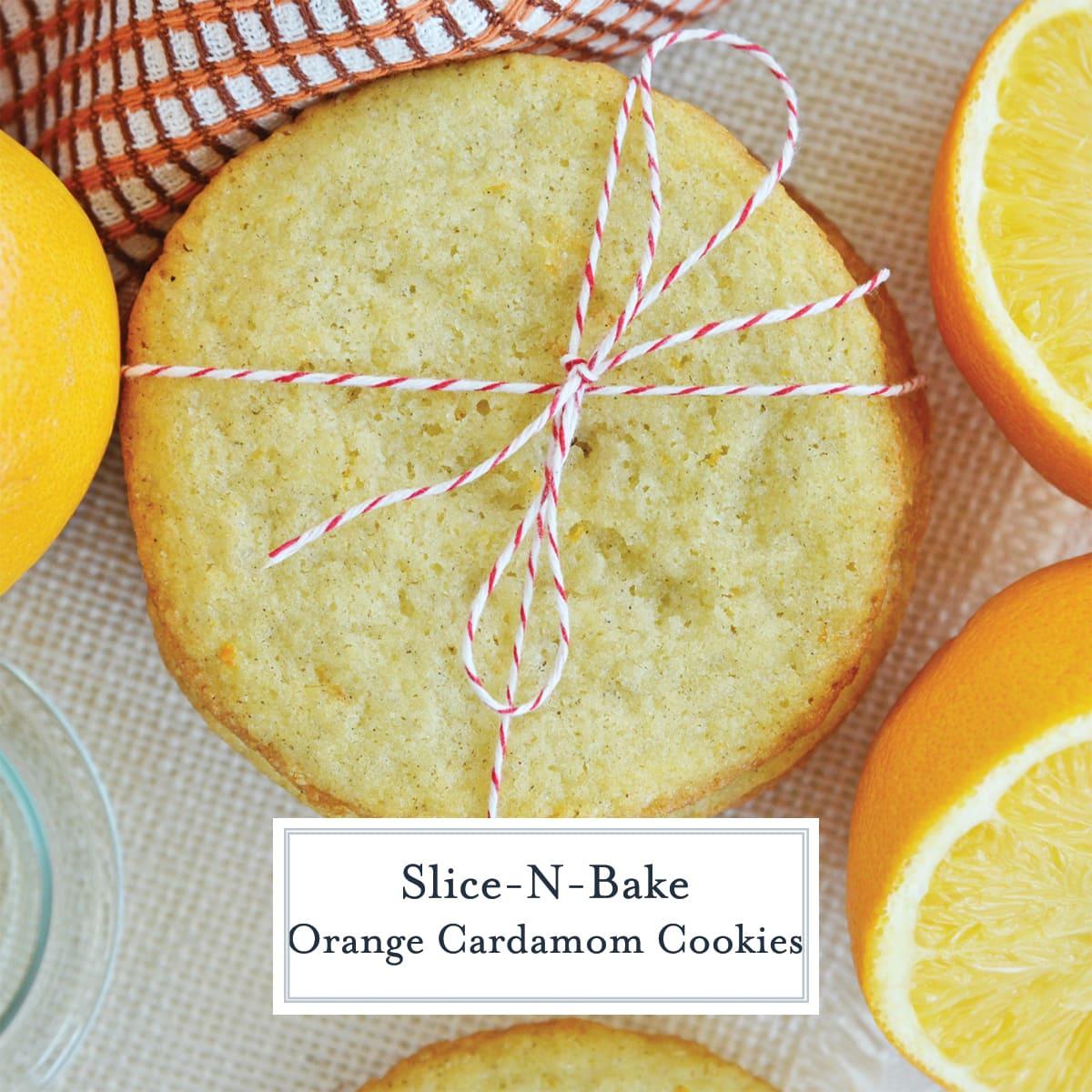 overhead of tied orange cardamom cookies with fresh oranges