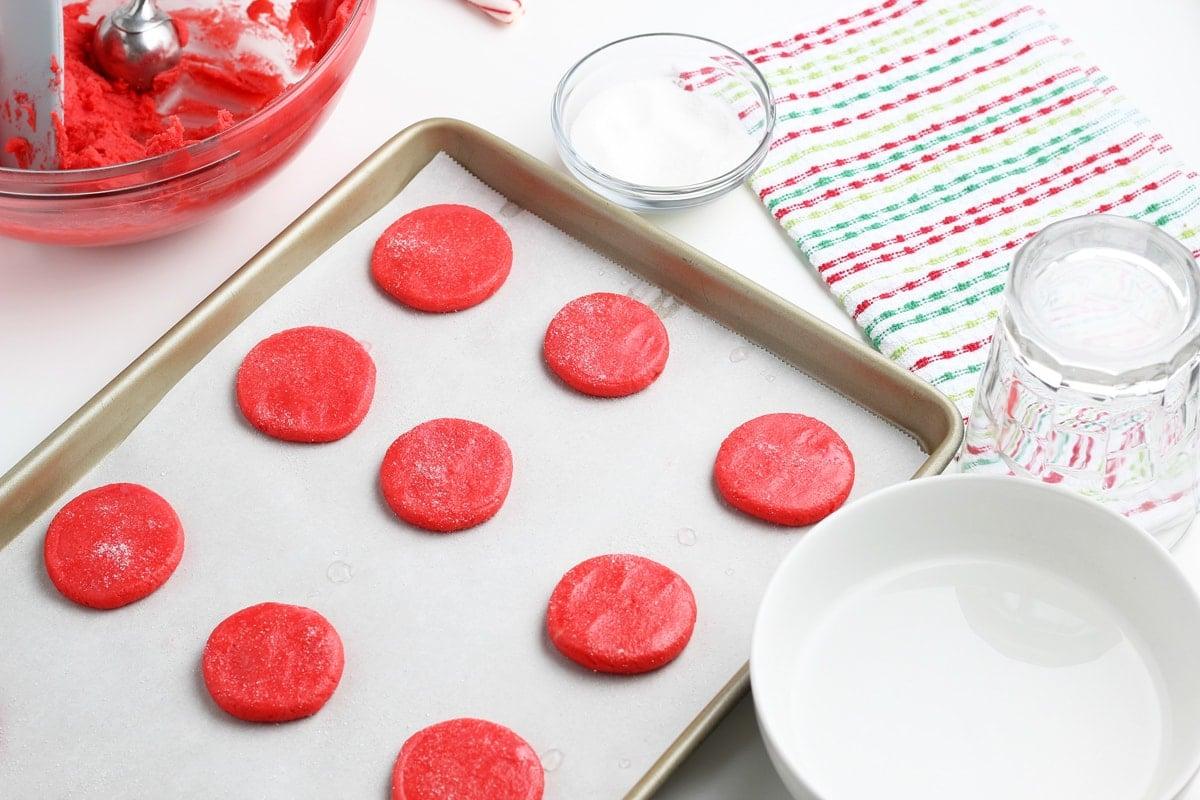 raw sugar cookies on a baking sheet