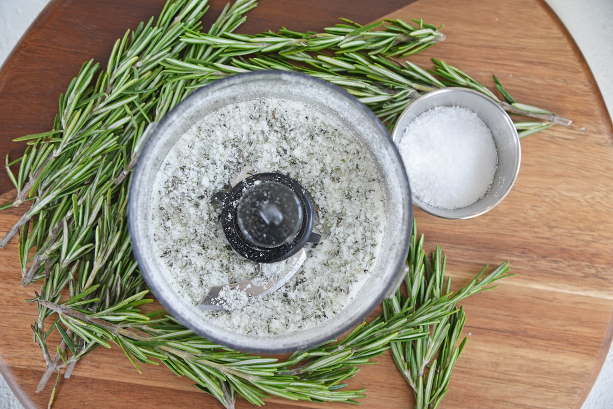 overhead of rosemary salt in a food processor