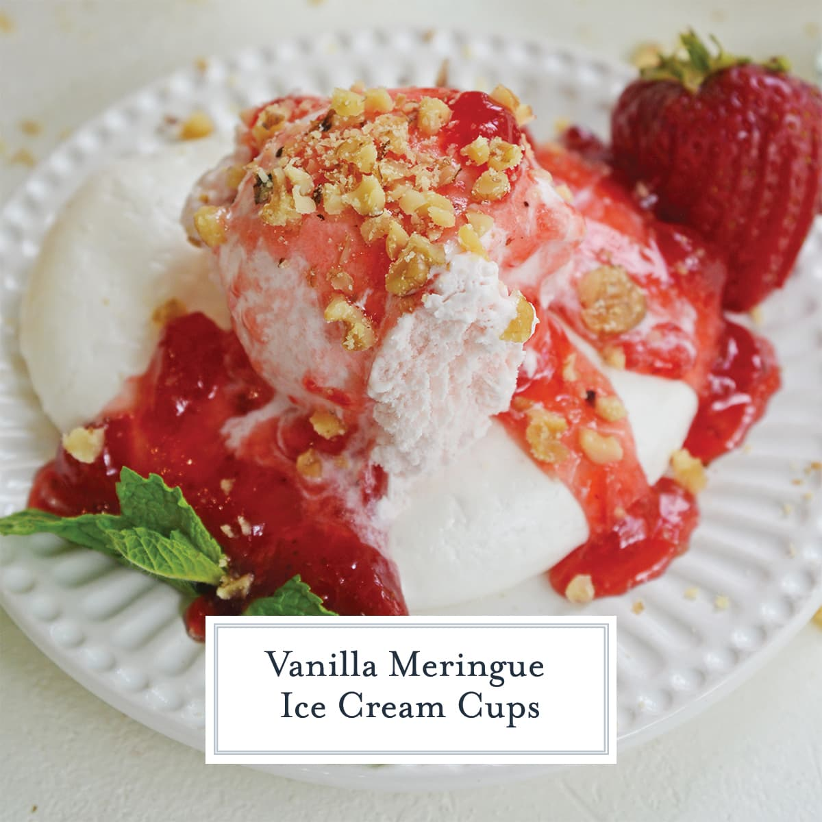 close up of strawberry ice cream in a meringue cup with strawberry topping
