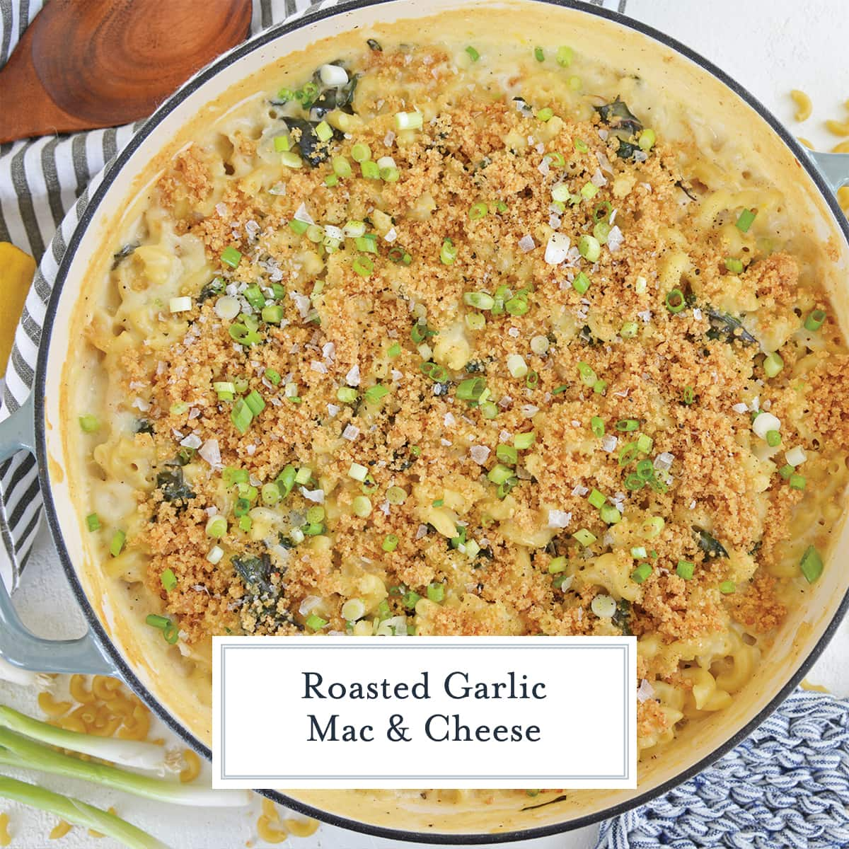 overhead of swiss chard mac and cheese with crunchy topping and scallions