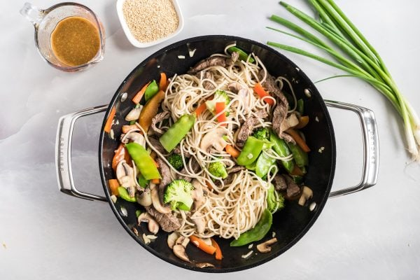 add noodles to wok