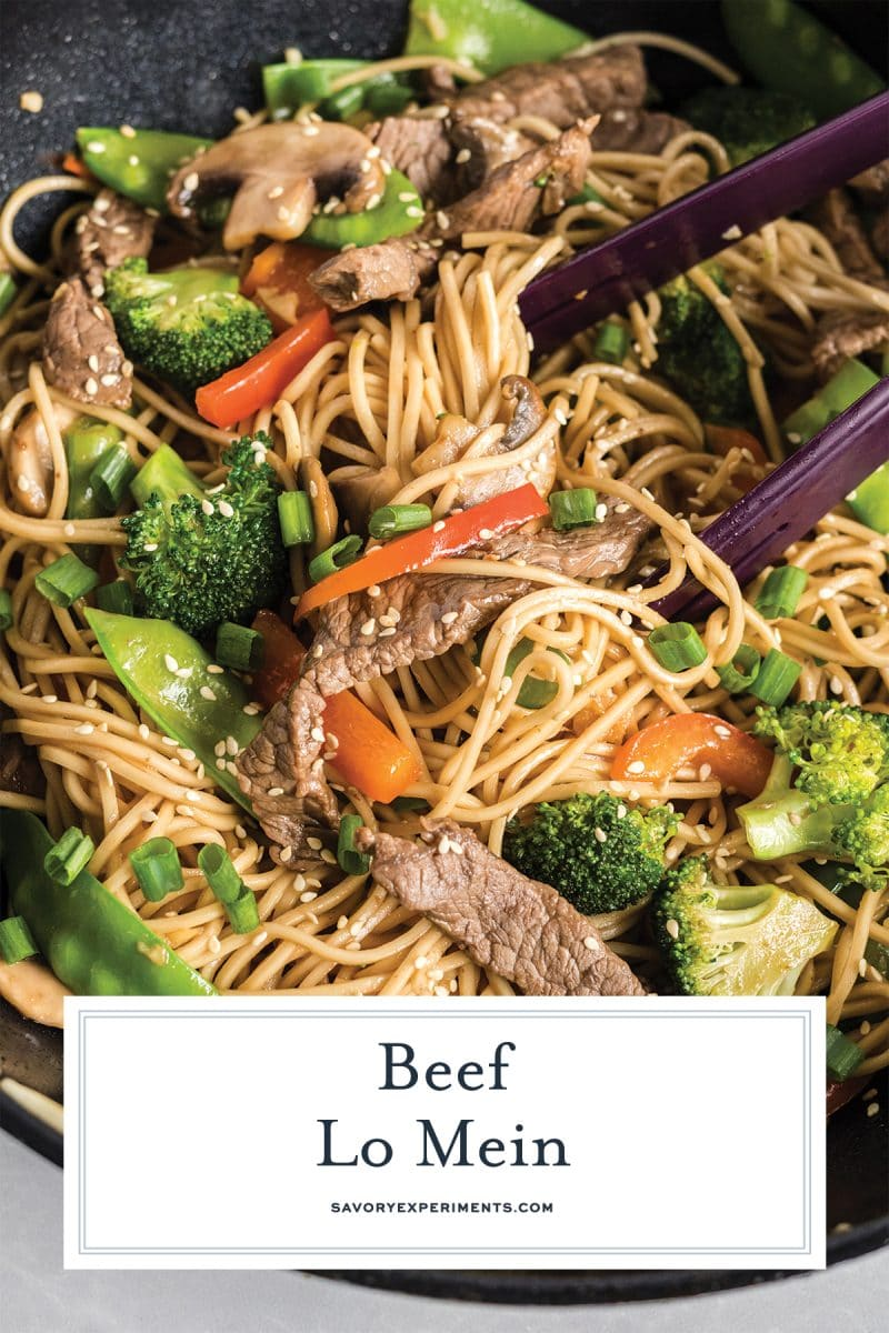 close up of beef lo mein with tongs for pinterest